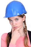 Pensive female construction worker. Stock Photo