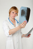 Pensive female doctor Stock Images
