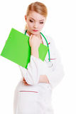Pensive female doctor or nurse with stethoscope green clipboard. Stock Photography
