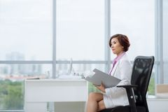 Pensive female entrepreneur Royalty Free Stock Photo