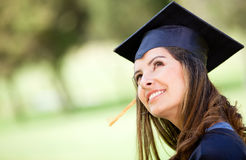 Pensive female graduate Stock Photography