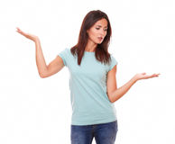 Pensive female holding her palms up Stock Photos