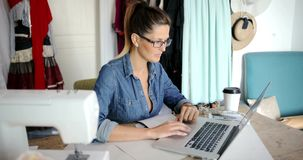Pensive female with laptop working stock footage