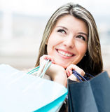 Pensive female shopper Stock Photography