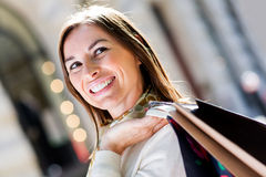Pensive female shopper Royalty Free Stock Photos