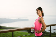 Pensive fitness woman looking the ocean Stock Image