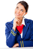Pensive flight attendant Stock Photo