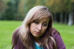 Pensive girl. Portrait of young pensive girl royalty free stock photography
