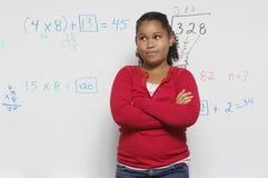 Pensive Girl Against Whiteboard Stock Photo