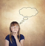 Pensive girl with blond hair Stock Images