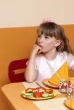 Pensive girl in cafe Stock Images