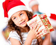 Pensive girl with a Christmas gift Royalty Free Stock Photo