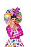 Pensive girl clown with a big colorful wig Stock Image