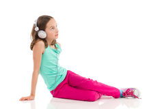 Pensive girl enjoying the music Royalty Free Stock Photography