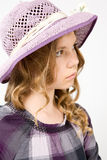 Pensive girl in a hat Stock Image