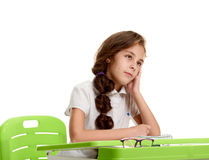 Pensive girl on lesson Royalty Free Stock Image