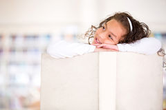 Pensive girl at the library Royalty Free Stock Photo