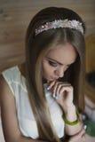 Pensive girl. Long hair. Bezel Stock Photography
