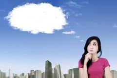 Pensive girl looking at cloud Royalty Free Stock Photos