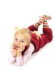 Pensive girl lying on the floor Royalty Free Stock Images