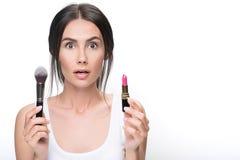 Pensive girl needs advice about make-up Stock Photos