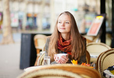 Pensive girl in a Parisian cafe Royalty Free Stock Photo