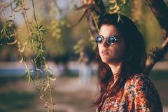 Pensive girl in the park Stock Photos