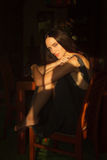 Pensive girl portrait. Interior shot Stock Images