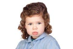 Pensive girl with preschool uniform Royalty Free Stock Image