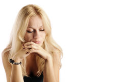 Pensive girl. Pretty blond girl looking down Royalty Free Stock Images