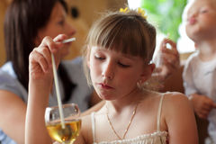 Pensive girl at restaurant Royalty Free Stock Images