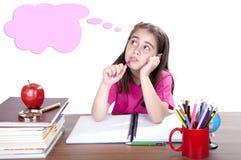 Pensive girl in school Stock Image