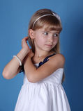 Pensive girl stroking hers hair. Beauty pensive girl stroking her hair Royalty Free Stock Photos