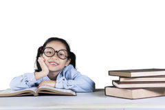 Pensive girl student with books on studio Stock Images