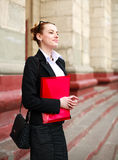 Pensive girl student with folder of documents Stock Photography