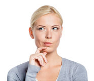 Pensive girl touching her face Stock Images