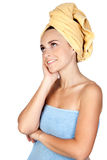 Pensive girl with towel Royalty Free Stock Image