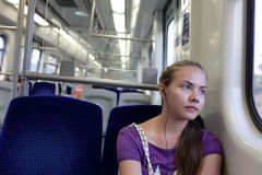 Pensive girl in train Royalty Free Stock Photography
