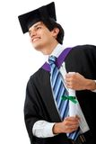 Pensive graduation man Royalty Free Stock Photography
