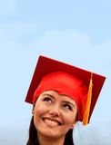 Pensive graduation woman Stock Images