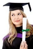 Pensive graduation woman Stock Photos