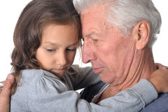 Pensive grandfather and granddaughter Stock Photography