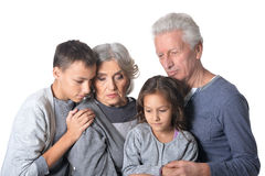 Pensive grandparents with kids Royalty Free Stock Photography
