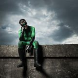 Pensive green superhero Royalty Free Stock Image