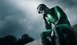 Pensive green superhero Stock Photos