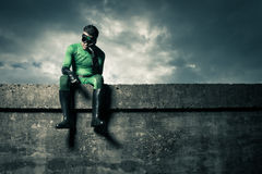 Pensive green superhero Stock Photography