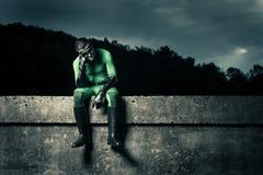 Pensive green superhero Royalty Free Stock Photo