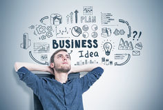 Pensive guy in an armchair, business idea Stock Photo