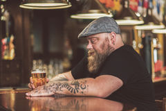 Pensive guy drinking light ale in pub Royalty Free Stock Image