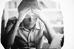Pensive guy in office. Pensive caucasian guy in office. Double exposure Stock Image